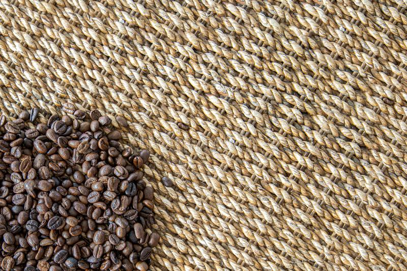 Coffee beans and water hyacinth wickerwork background. Fresh coffee beans and water hyacinth natural wickerwork background. Closeup top view, brown, aroma, beige royalty free stock image