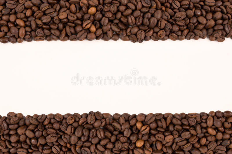 Coffee beans on a white background. A lot off coffee beans on a white background royalty free stock image
