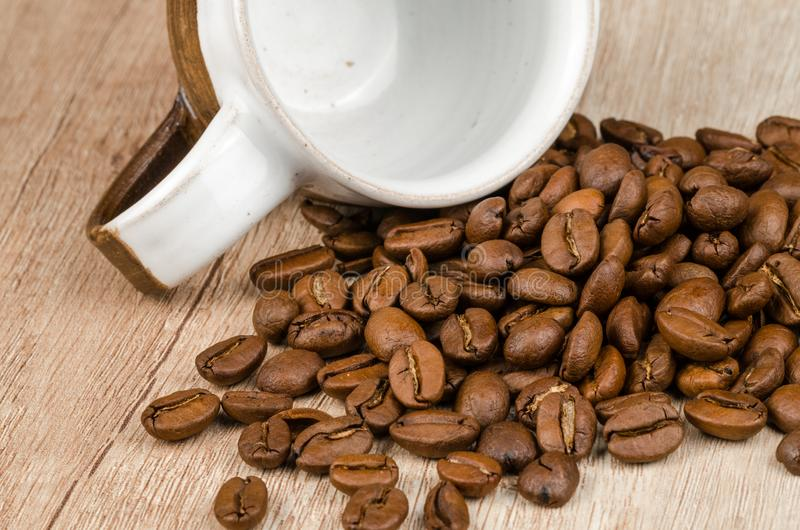 Coffee Beans Beside White and Brown Ceramic Mug stock image