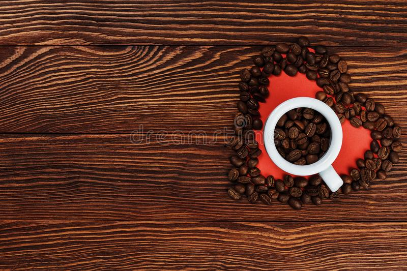 Coffee beans in a white cup stock image