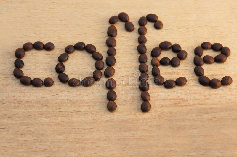 Download Coffee beans on a wood stock photo. Image of beverage - 25226390