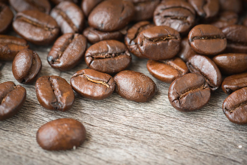 Coffee beans on the wood stock photography