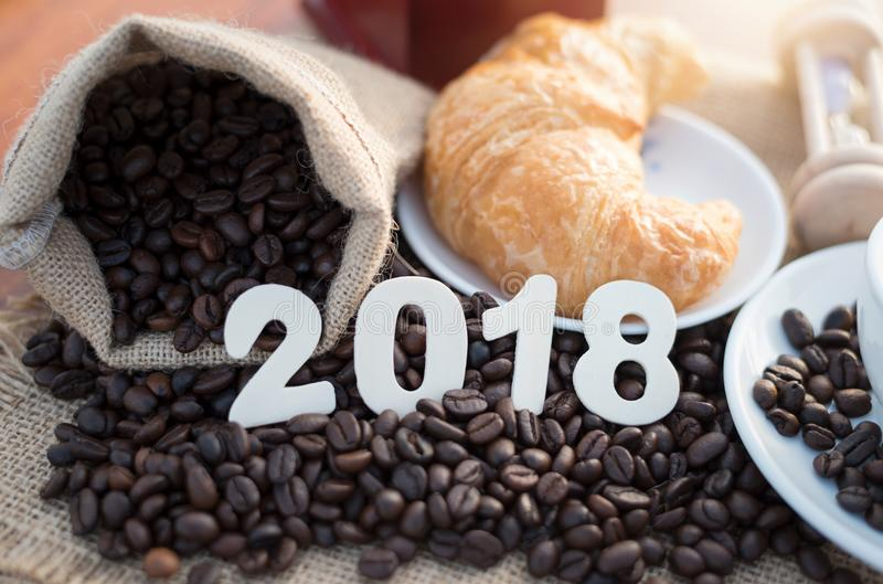 2018 coffee beans on wood table and new year concept royalty free stock photos