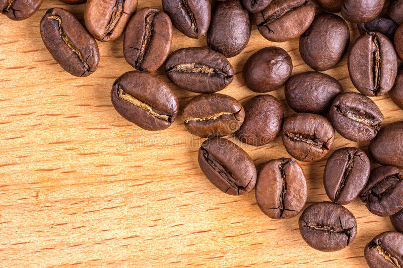 Download Coffee Beans On Wooden Background Royalty Free Stock Images - Image: 36300569