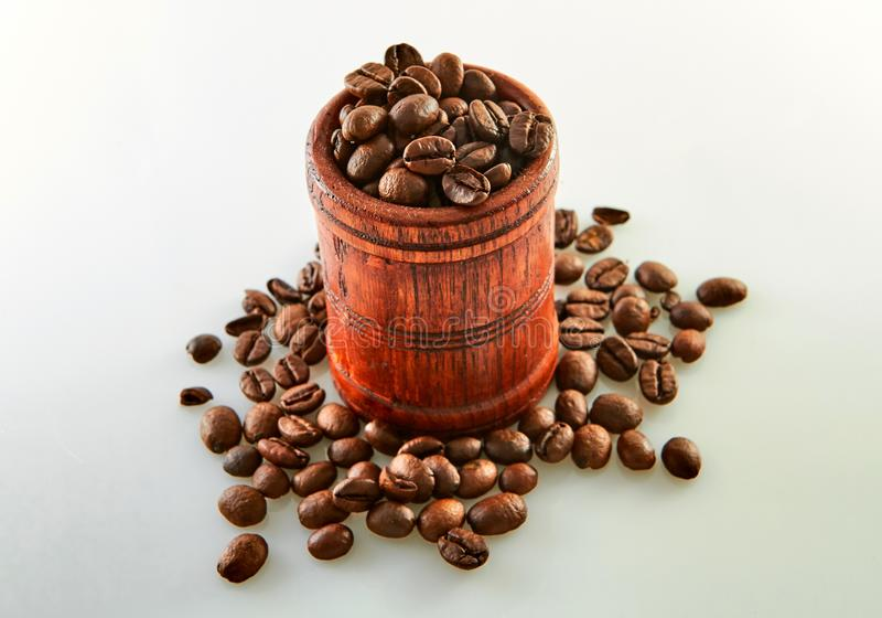 Coffee beans in a wooden barrel isolated on white. Background, agriculture, arabic, aroma, aromatic, beverage, black, breakfast, brown, cafe, caffeine stock photo