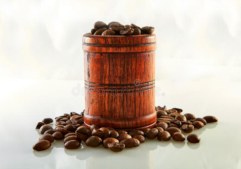 Coffee beans in a wooden barrel isolated on white. Background, agriculture, arabic, aroma, aromatic, beverage, black, breakfast, brown, cafe, caffeine stock image