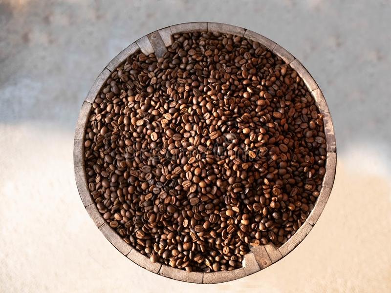 Coffee beans in a wooden barrels isolated on cement background, Top view stock photo