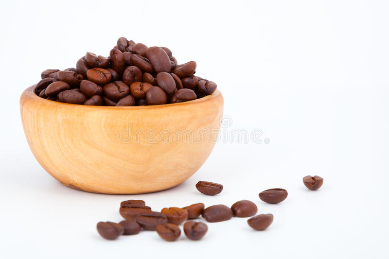 Coffee beans. In the wooden bowl, on white background stock photos