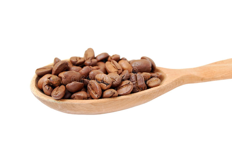 Coffee beans in wooden spoon royalty free stock photo