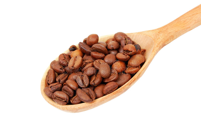 Coffee beans in wooden spoon royalty free stock photos