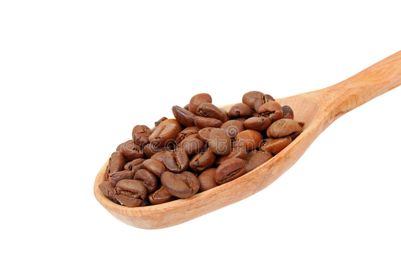 Coffee beans in wooden spoon stock photo