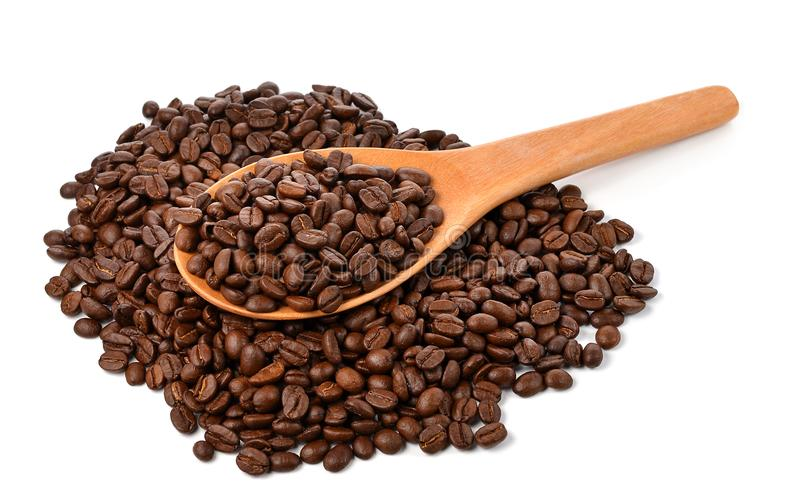 Coffee beans with wooden spoon isolated on white background stock photo