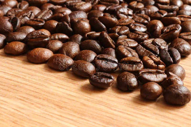 Coffee beans on a wooden table royalty free stock photography