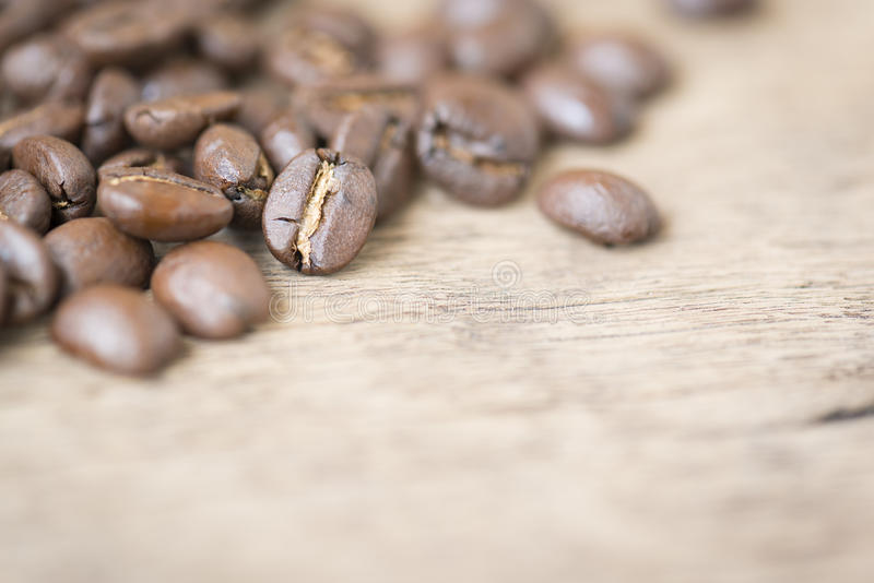 Coffee beans on the wooden top royalty free stock image