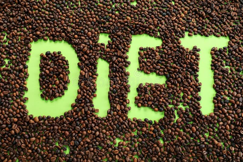 Coffee beans with word Diet. Healthy food concept stock photography