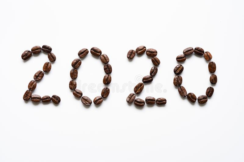 Coffee beans and word 2020. Top view of coffee beans and word 2020 for Happy New Year Concept. on white background stock photo