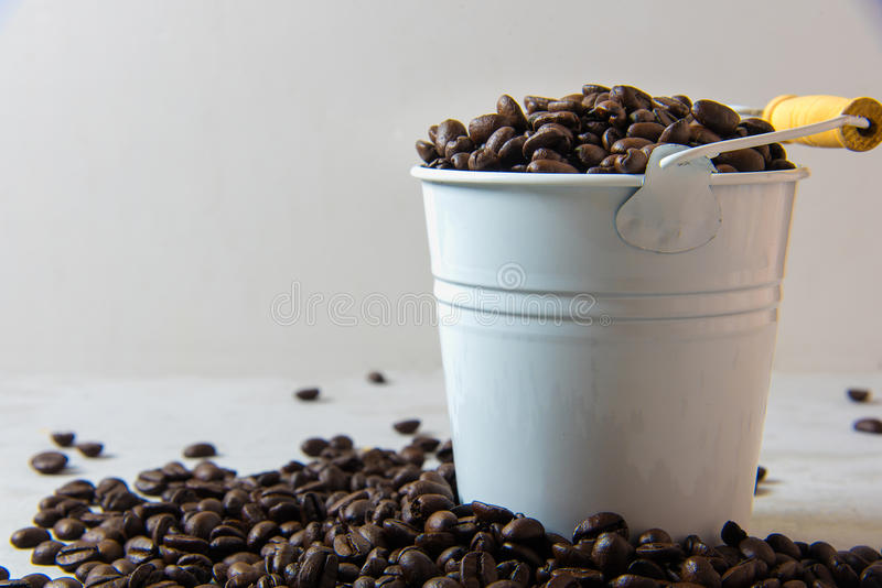 Coffee beans. With zinc bucket royalty free stock photo