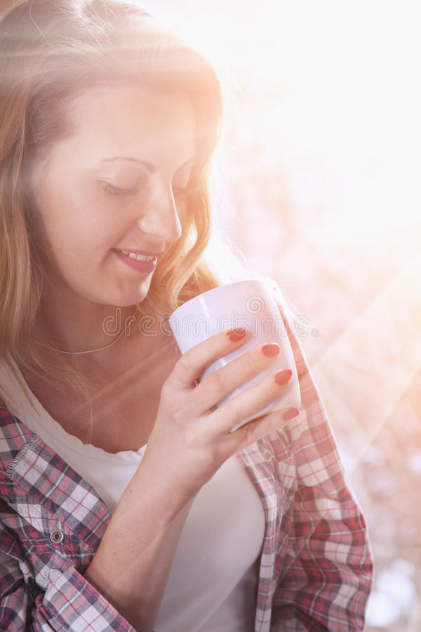 Coffee. Beautiful Girl Drinking morning Coffee. Beauty Model Woman with the Cup of Beverage. stock image