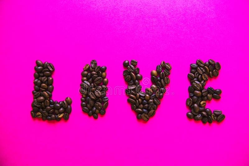 Coffee beens on background. Word Food. Coffee beens on pink background. Word Food royalty free stock images