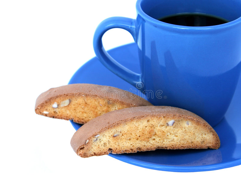 Coffee & Biscotti Closeup (isolated). Coffee in a blue cup with biscotti on the side. Isolated stock image