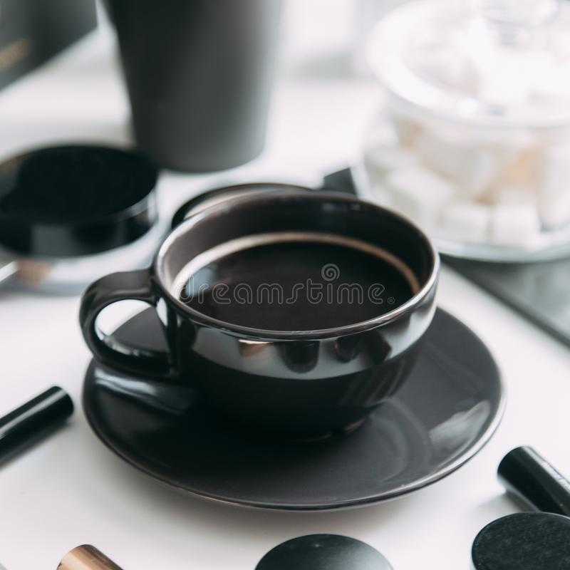 Coffee with a in the black a Cup. stock photography