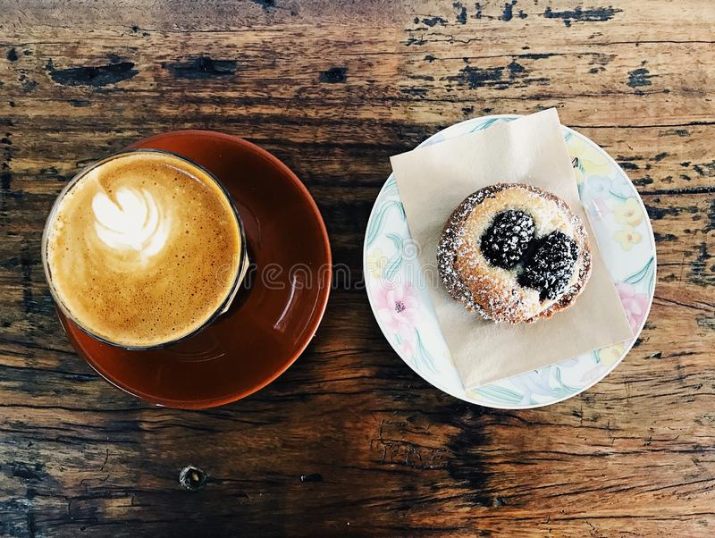 Coffee and blackBerry tart on the table. Morning tea stock image