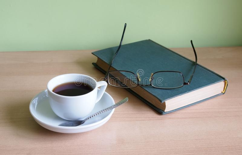 Download Coffee and a book stock image. Image of glasses, drink - 18094299