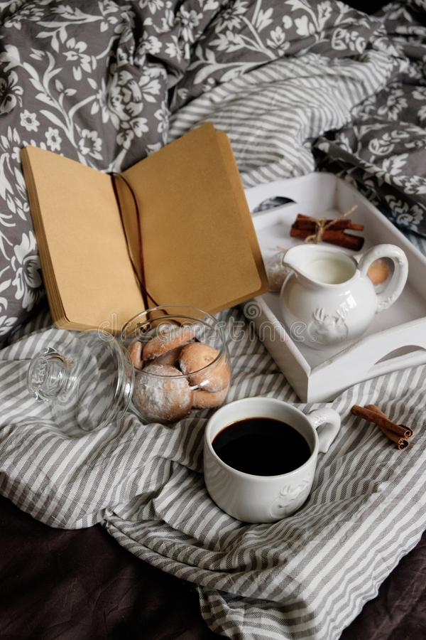 Coffee with a book in bed. interior details. Scandinavian style. stock photos