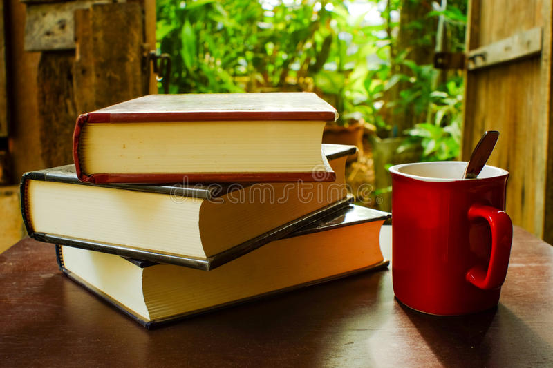 Coffee and books. On a wooden table brown.. & x28;During the warm sunshine& x29 stock photography