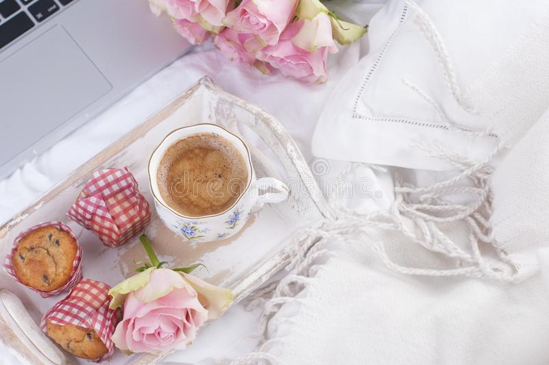 Coffee and bouquet of pink roses in bed, romance and coziness. Good morning. Breakfast in bed. Copy space.  stock images