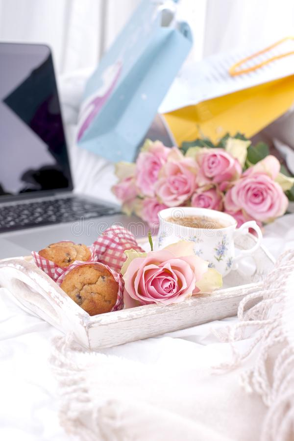 Coffee and bouquet of pink roses in bed, romance and coziness. Good morning. Breakfast in bed. Copy space.  stock image