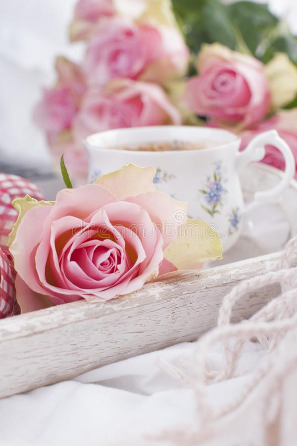 Coffee and bouquet of pink roses in bed, romance and coziness. Good morning. Breakfast in bed. Copy space.  royalty free stock image