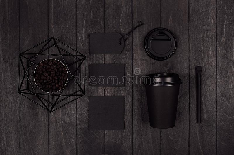 Coffee branding identity mockup in light modern style - black paper cup, blank card, label, cap, statuette with coffee beans. Coffee branding identity mockup in stock images