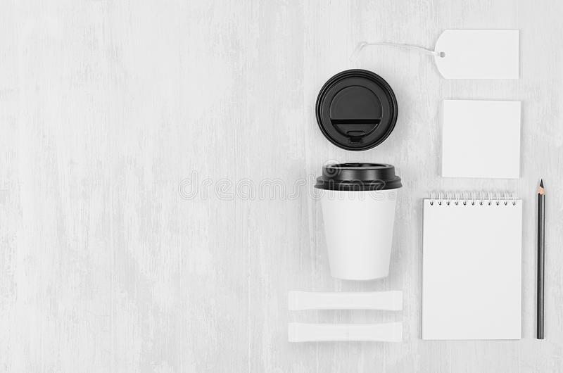 Coffee branding identity mockup in light modern style - white paper cup, blank notebook, card, label, stationery, sugar. Coffee branding identity mockup in royalty free stock image