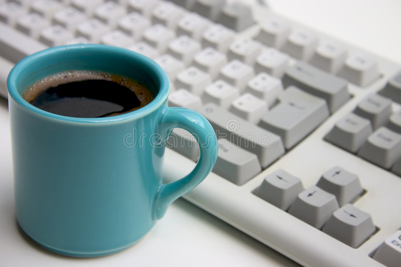 Coffee breack. On workplace stock image