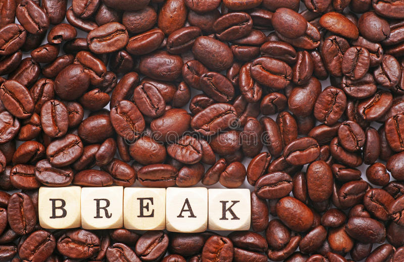 Coffee Break. Letter cubes on top of coffee beans spell out break royalty free stock image