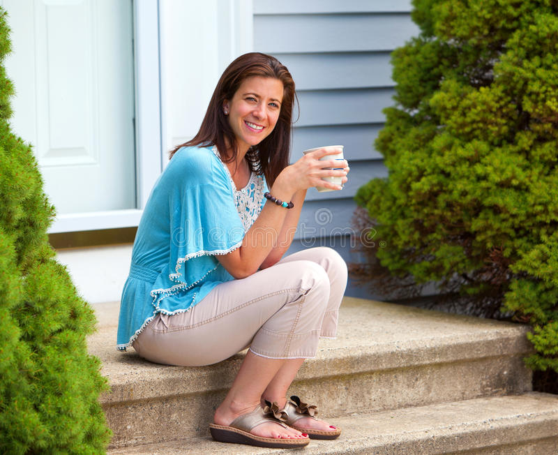 Coffee break. Beautiful woman taking a coffee break holding a mug stock photos