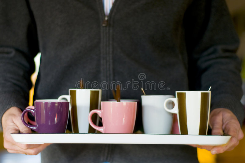 Coffee break. With colleagues with lots of mugs and spoons stock image