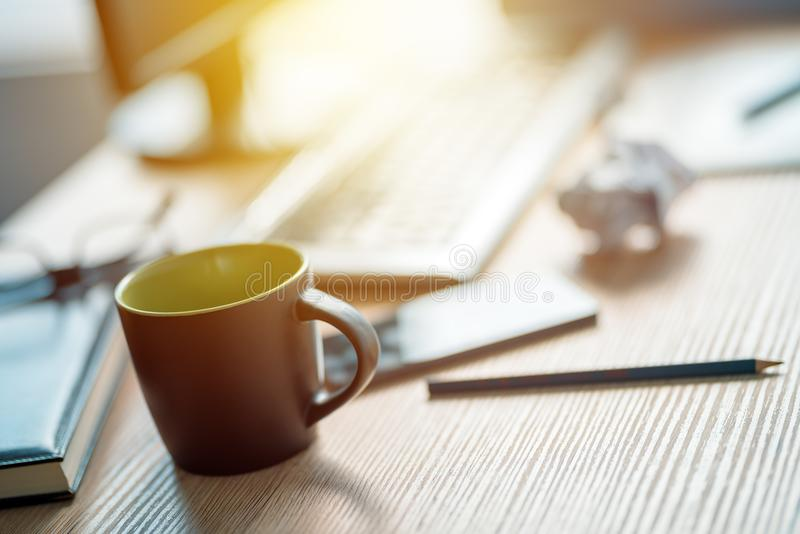 Coffee break in architecrure and interior design studio. Coffee break in architecture and interior design studio, black cup of hot drink on office desk royalty free stock image