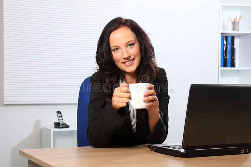 Download Coffee Break For Beautiful Woman At Office Desk Stock Photo - Image: 18808594