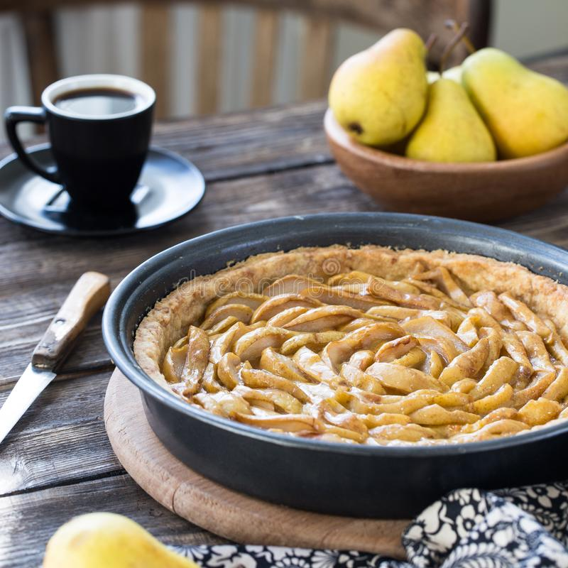 Coffee break with french pear tart. Coffee break or breakfast with french pear tart and coffee stock photography