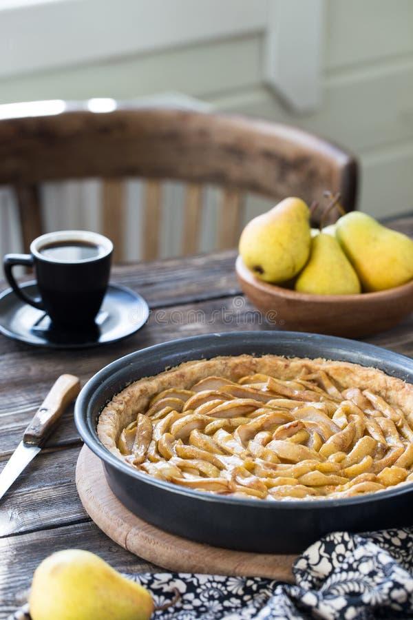 Coffee break with french pear tart. Coffee break or breakfast with french pear tart and coffee royalty free stock photos