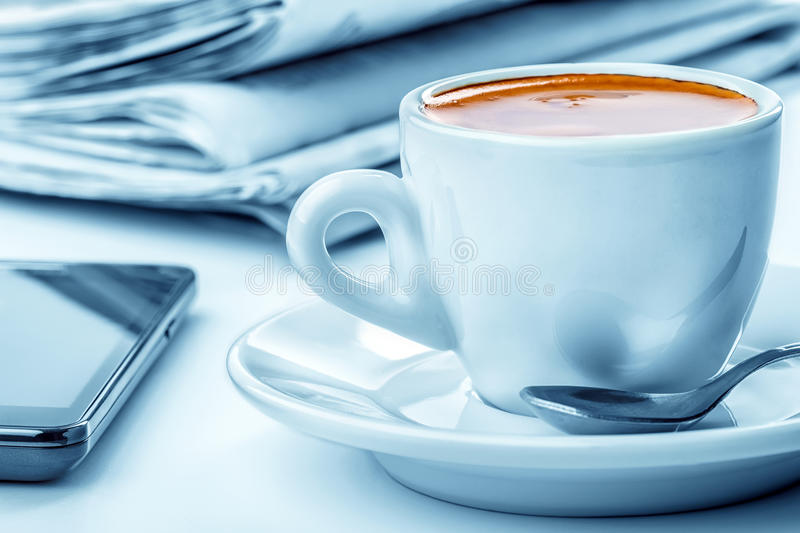 Coffee break business. Business coffee break. Cell Phone and newspapers royalty free stock image