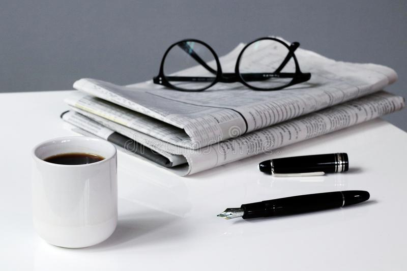 Coffee break business with Newspaper Pen and Glasses royalty free stock photo