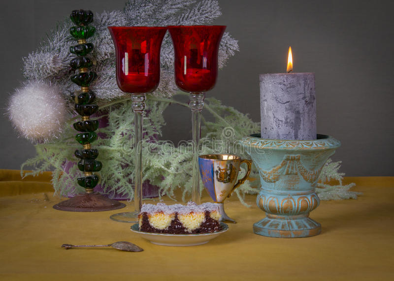 Coffee break with Christmas decoration, biscuit and candlelight royalty free stock images