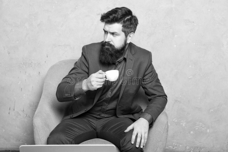 Coffee break concept. Business people. Best coffee served for him. Attractive pensive manager in thoughtful mood. Coffee royalty free stock photography