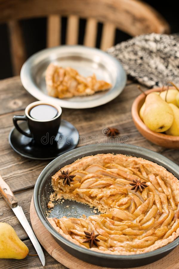Coffee break with french pear tart. Coffee break or breakfast with french pear tart and coffee royalty free stock images