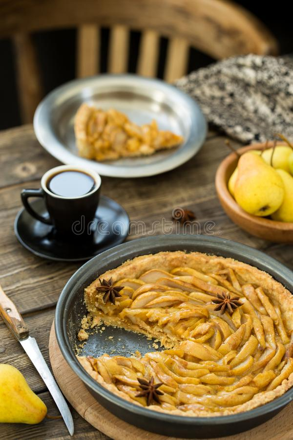 Coffee break with french pear tart. Coffee break or breakfast with french pear tart and coffee royalty free stock image