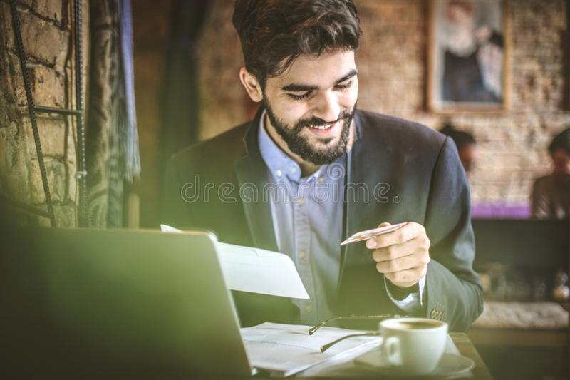 Coffee break is good time to pay bills online. Close up image royalty free stock image