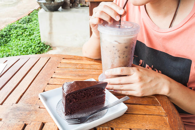 Coffee break with iced coffee and cake stock image
